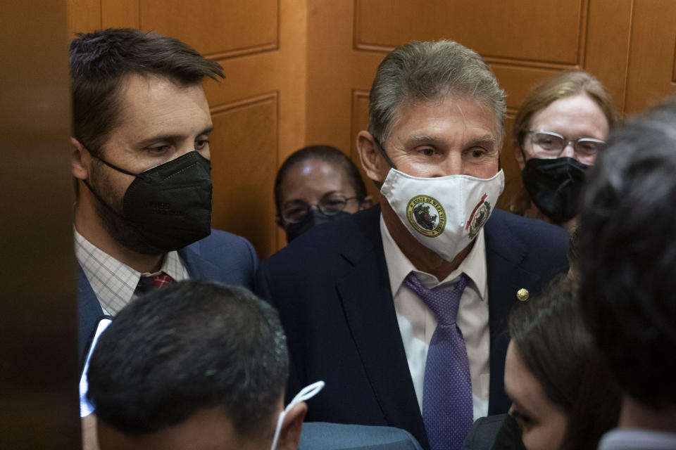 Sen. Joe Manchin, D-W.Va., squeezes into an elevator with White House domestic policy adviser Susan Rice, center, Director of the National Economic Council Brian Deese, left, and other White House officials as they leave a private meeting with Sen. Kyrsten Sinema, D-Ariz., on Capitol Hill in Washington, Thursday, Sept. 30, 2021. Determined not to let his $3.5 trillion government overhaul collapse, President Joe Biden cleared his schedule late Thursday and Speaker Nancy Pelosi pushed the House into an evening session as the Democratic leaders worked to negotiate a scaled-back plan centrist holdouts would accept. (AP Photo/Andrew Harnik)