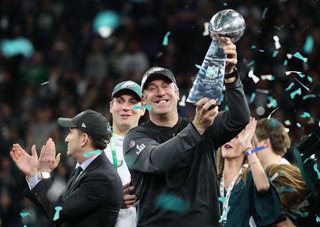 NFL Football - Philadelphia Eagles v New England Patriots - Super Bowl LII - U.S. Bank Stadium, Minneapolis, Minnesota, U.S. - February 4, 2018. Philadelphia Eagles head coach Doug Pederson celebrates winning Super Bowl LII with the Vince Lombardi Trophy. REUTERS/Chris Wattie