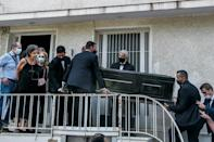 Family and friends escort the coffin of Greek composer Mikis Theodorakis from his Athens home (AFP/eurokinissi/Michalis Karagiannis)