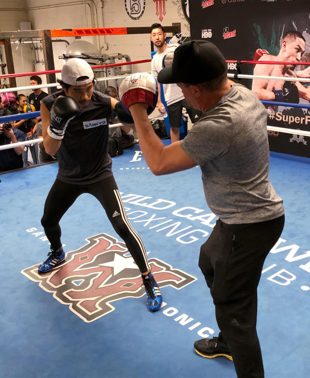 Super flyweight Kazuto Ioka, left, of Japan, spars with trainer Ismael Salas at the Wild Card West gym in Santa Monica, Calif., Wednesday, Sept. 5, 2018. Ioka is ending his brief retirement to make his U.S. debut against McWilliams Arroyo at the Forum on Saturday. He hopes the bout will lead to a title shot in his fourth weight class. (AP Photo/Greg Beacham)