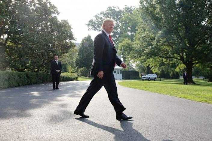 President Trump leaves the White House on Saturday morning. (Photo: Zach Gibson/Reuters)