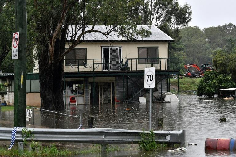"""The Bureau of Meteorology tweeted that """"unfortunately this situation is far from over"""", with half of New South Wales now under weather warnings"""