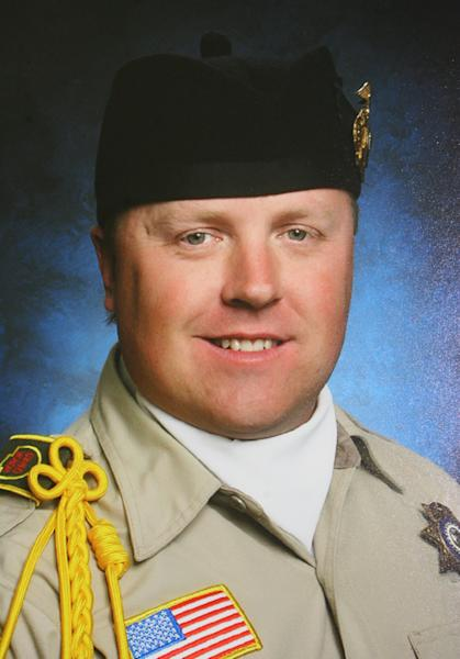 This photo provided by the San Bernardino sheriff's department shows slain San Bernardino Sheriff Deputy Jeremiah MacKay. MacKay was killed Tuesday, Feb. 12, 2013 during a shootout outside the cabin where fugitive ex-Los Angeles police officer Christopher Dorner was believed to be barricaded inside in Big Bear, Calif. After the firefight ended, a SWAT team using an armored vehicle broke out the cabin's windows and began knocking down walls. A fire broke out and later charred remains believed to be Dorner's were found. (AP Photo/San Bernardino Sheriff's Department via The Riverside Press-Enterprise)