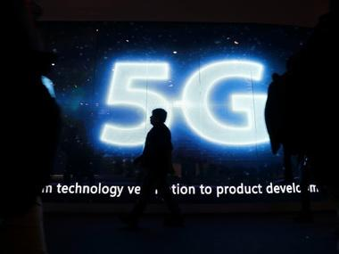 A visitor walks past a 5G sign during Mobile World Congress in Barcelona. Reuters.