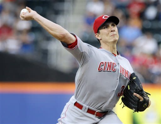 Cincinnati Reds' Homer Bailey delivers a pitch during the first inning of a baseball game against the New York Mets, Saturday, June 16, 2012, in New York. (AP Photo/Frank Franklin II)