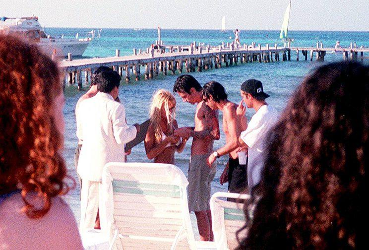 Pamela Anderson and Tommy Lee get married February 19, 1995 on the beach in Cancun, Mexico.