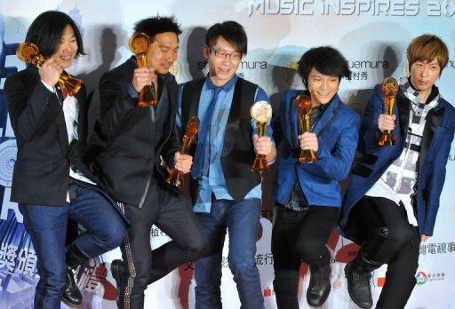 Taiwan's pop music group Mayday pose with their trophies after winning multiple awards