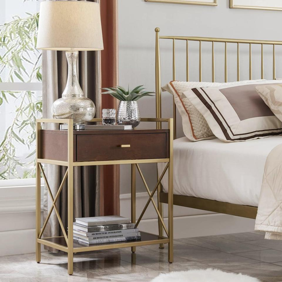 <p>If you love the combination of wood and brass, this embellished <span> Brayden Studio Nightstand</span> ($240, originally $260) brings your two favorite materials together.</p>