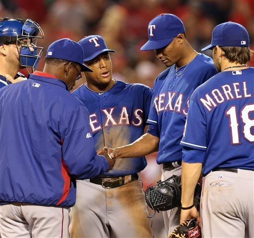 Texas Rangers starting pitcher Alexi Ogando is taken out of the game in the eighth inning of a baseball game against the Los Angeles Angels in Anaheim, Calif., on Tuesday, April 23, 2013. (AP Photo/Christine Cotter)