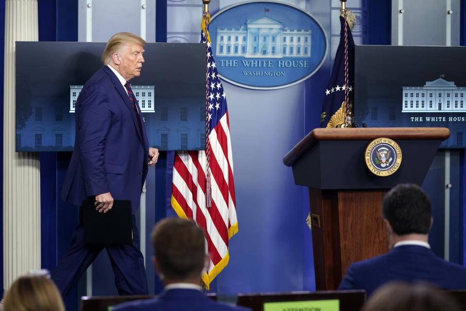 President Donald Trump arrives for a news conference in the James Brady Press Briefing Room at the White House, Friday, Sept. 4, 2020, in Washington. (AP Photo/Evan Vucci)