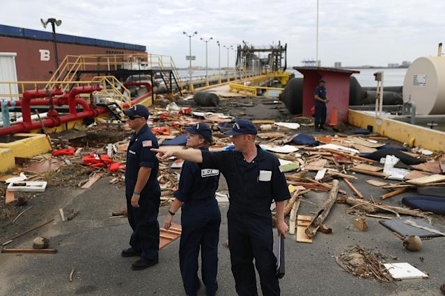<p>U.S. Coast Guard personnel survey the damage to an oil dock after Hurricane Maria passed through the area on Sept. 23, 2017 in San Juan, Puerto Rico. (Photo: Joe Raedle/Getty Images) </p>