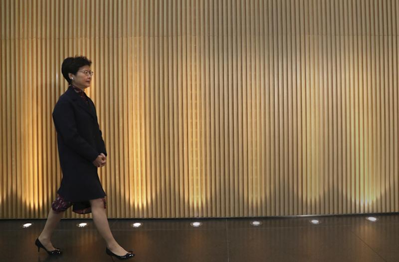 In this Thursday, Jan. 12, 2017 photo, Hong Kong's Chief Secretary Carrie Lam arrives at a press conference at the government headquarters to announce her resignation in Hong Kong. The No. 2 government official who announced her resignation, and Hong Kong's Financial Secretary John Tsang, who resigned last month, are widely expected to mount leadership bids for the job of Hong Kong's top leader after current Chief Executive Leung Chun-ying said he would not go for a second term. (AP Photo/Vincent Yu, File)