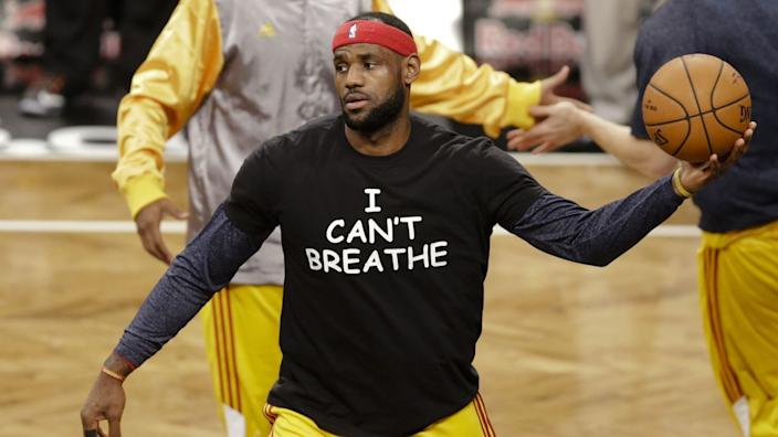 """LeBron James wears a T-shirt reading """"I Can't Breathe,"""" during warmups before a Cavaliers game on Dec. 8, 2014. <span class=""""copyright"""">(Frank Franklin II / Associated Press)</span>"""