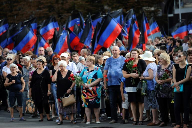 People line the streets of Donetsk to pay respects to an assassinated rebel leader in east Ukraine