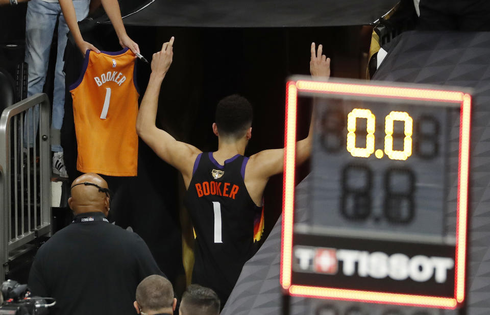Devin Booker and the Phoenix Suns are two wins away from their first NBA championship. (Chris Coduto/Getty Images)