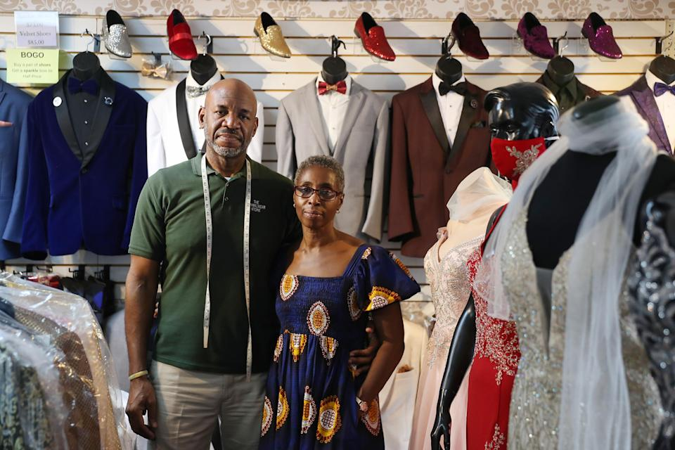 MIAMI GARDENS, FLORIDA - JULY 07: James Robinson and his wife Perlina Robinson pose for a portrait in The Formalwear store on Blackout Day 2020 on July 07, 2020 in Miami Gardens, Florida. They have owned the business for the last 22 years. Supporters of Blackout Day have committed to only spending money at black-owned businesses to showcase the economic power of the Black community. (Photo by Joe Raedle/Getty Images)