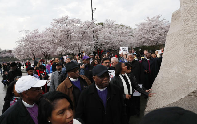 <p>Anti-racism marchers from the National Council of the Churches of Christ in the USA and ACT (Awaken, Confront, Transform) to End Racism reach out to touch the Rev. Martin Luther King Jr. Memorial as they engage in a silent march and rally to mark the 50th anniversary of the slain civil rights leader's assassination in Washington, April 4, 2018. (Photo: Leah Millis/Reuters) </p>