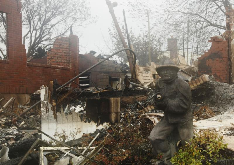 A home damaged by fire is shown in the Belle Harbor neighborhood in the New York City borough of Queens Tuesday, Oct. 30, 2012, in New York. Sandy, the storm that made landfall Monday, caused multiple fatalities, halted mass transit and cut power to more than 6 million homes and businesses. (AP Photo/Frank Franklin II)