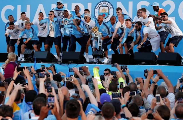 Soccer Football - Premier League - Manchester City Premier League Title Winners Parade - Manchester, Britain - May 14, 2018 Manchester City's Vincent Kompany lifts the Premier League trophy during the parade Action Images via Reuters/Andrew Boyers