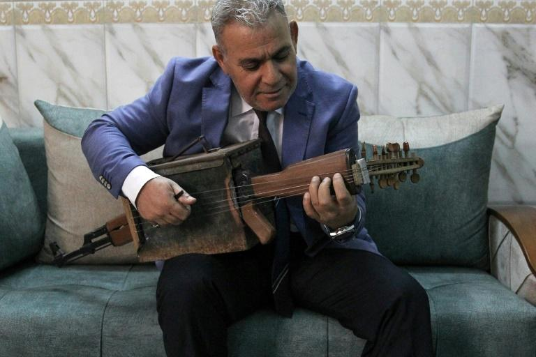 Majed Abdennour transformed a Kalashnikov into a musical instrument (AFP Photo/AHMAD AL-RUBAYE)