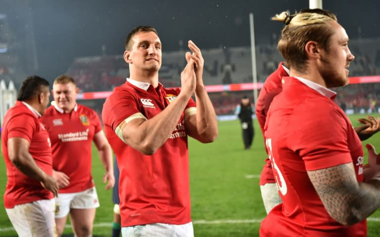 British and Irish Lions captain Sam Warburton, who announced his retirement Wednesday, applauds fans after what turned out to be his last international match,  third Test between the Lions and New Zealand All Blacks at Eden Park in Auckland on July 8, 2017