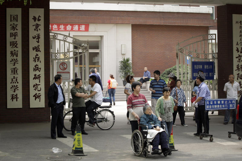 People enter and exit the hospital where Chinese legal activist Chen Guangcheng was taken to receive medical care in Beijing, Monday, May 7, 2012. Chen, a symbol in China's civil rights movement, may be able to leave to study in the United States under still-evolving arrangements announced Friday, May 4, 2012, by Washington and Beijing to end a weeklong diplomatic standoff over his case. (AP Photo/Vincent Thian)