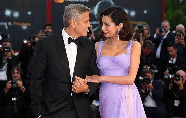 George and Amal have their hands full with two bubs! Source: Getty