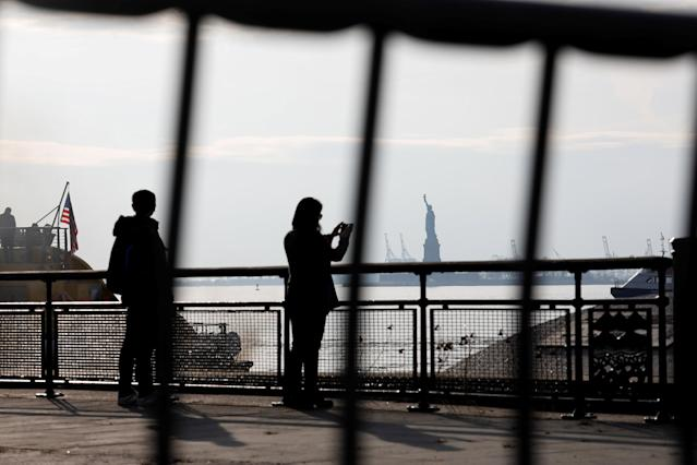 The Statue of Liberty is seen through fencing from a ferry dock following a U.S. government shutdown in Manhattan, New York, U.S., in New York, U.S. January 21, 2018. REUTERS/Shannon Stapleton TPX IMAGES OF THE DAY