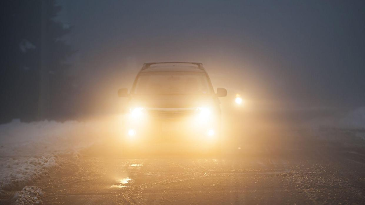 car driving with fog lights