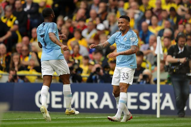 Gabriel Jesus of Manchester City celebrates with teammate Raheem Sterling after scoring his team's second goal during the FA Cup Final match between Manchester City and Watford at Wembley Stadium.