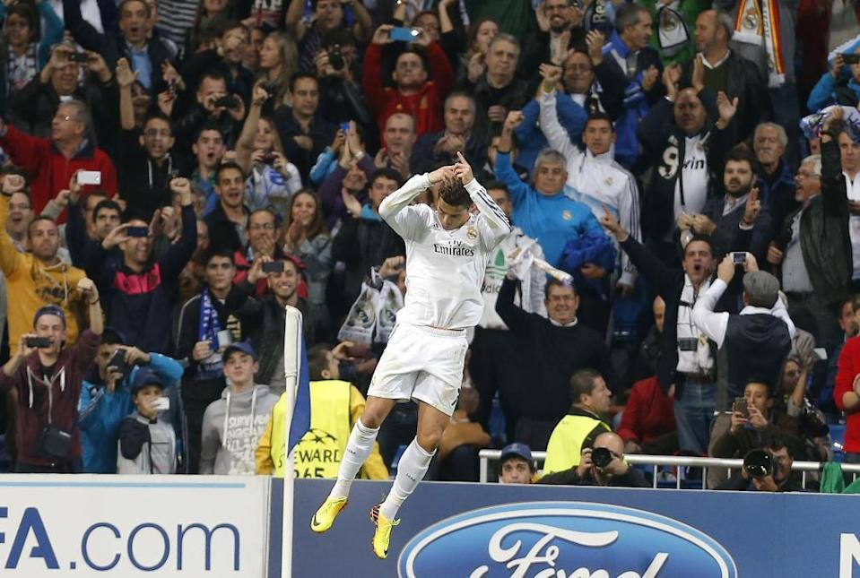 Real's Cristiano Ronaldo celebrates scoring his side's second goal during a Group B Champions League soccer match between Real Madrid and Juventus at the Santiago Bernabeu stadium in Madrid, Spain, Wednesday Oct. 23, 2013. (AP Photo/Paul White)
