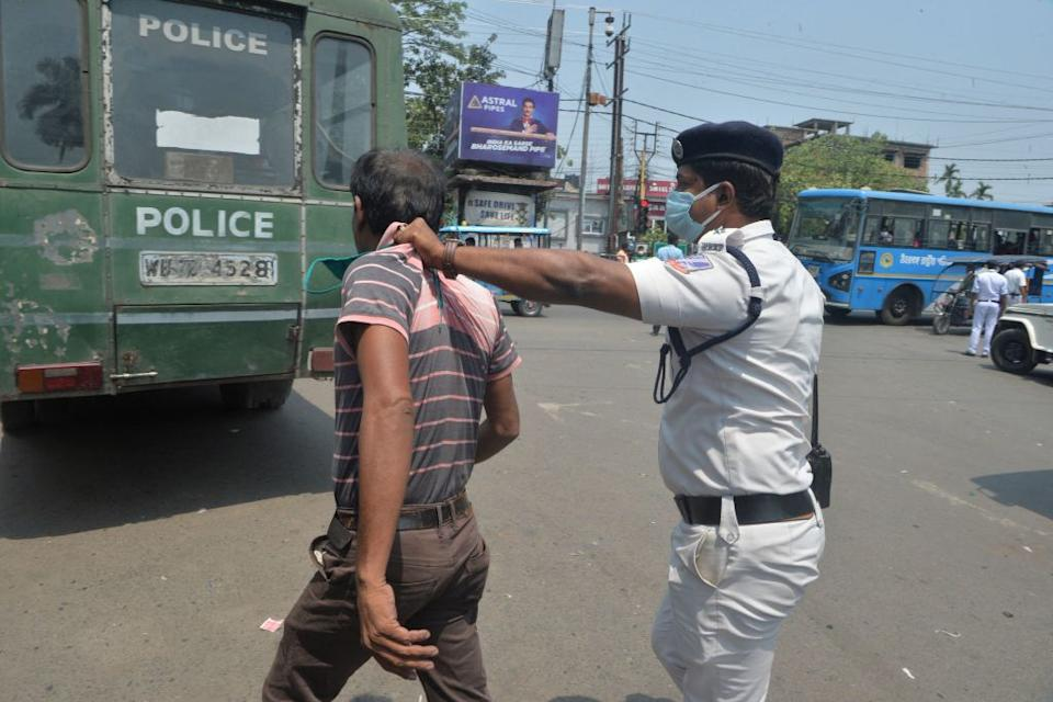 Police detain people who flouted the Covid-19 coronavirus safety protocols of wearing face mask during an awareness drive held in Siliguri.