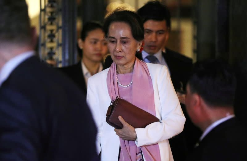 Myanmar's leader Aung San Suu Kyi leaves the International Court of Justice (ICJ), the top United Nations court, after court hearings in a case filed by Gambia against Myanmar alleging genocide against the minority Muslim Rohingya population, in The Hague