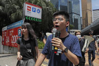 In this June 21, 2019, photo, pro-democracy activists Agnes Chow, left, and Joshua Wong march to police headquarters in Hong Kong. Demosisto, a pro-democracy group in Hong Kong posted on its social media accounts that well-known activist Joshua Wong had been pushed into a private car around 7:30 a.m. Friday, Aug. 30, 2019 and was taken to police headquarters. It later said another member, Agnes Chow, had been arrested as well. (AP Photo/Kin Cheung)