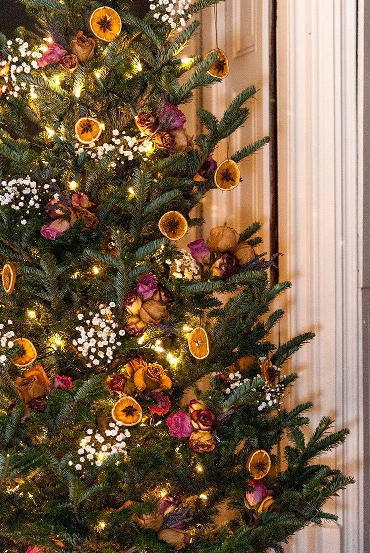 "<p>Use dried citrus fruit along with purple roses and other natural accents for an elegant, plastic-free tree this year.</p><p>Get the tutorial at <a href=""https://www.shekeepsalovelyhome.com/dried-citrus-christmas-ornaments/"" rel=""nofollow noopener"" target=""_blank"" data-ylk=""slk:She Keeps A Lovely Home"" class=""link rapid-noclick-resp"">She Keeps A Lovely Home</a>.</p><p><a class=""link rapid-noclick-resp"" href=""https://www.amazon.com/Bright-Creations-Twine-String-Crafts/dp/B07Y45VGX5/ref=asc_df_B07Y45VGX5/?tag=syn-yahoo-20&linkCode=df0&hvadid=416655954853&hvadid=416655954853&hvnetw=g&hvnetw=g&hvrand=13360672725609923709&hvrand=13360672725609923709&hvdev=c&hvdev=c&hvlocphy=9067609&hvlocphy=9067609&hvtargid=pla-872544439638&hvtargid=pla-872544439638&psc=1&adgrpid=93602481573&ascsubtag=%5Bartid%7C10057.g.505%5Bsrc%7Cyahoo-us"" rel=""nofollow noopener"" target=""_blank"" data-ylk=""slk:SHOP STRING"">SHOP STRING</a> <strong><em>Black String, $8</em></strong></p>"