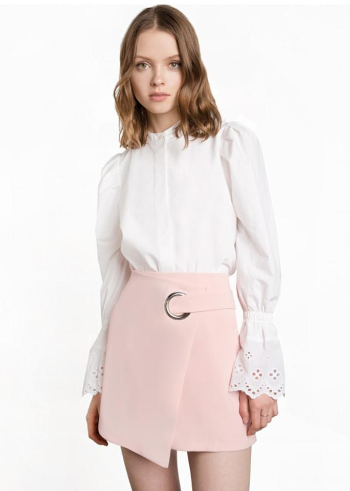 "Pixie Market Pink Ring Wrap Mini Skirt, $96; at <a rel=""nofollow"" href=""http://www.pixiemarket.com/pink-ring-wrap-mini-skirt.html"" rel="""">Pixie Market</a>"