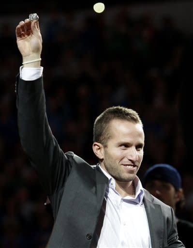 Minnesota Timberwolves' Jose Juan Barea, of Puerto Rico, holds up his NBA championship ring during a ceremony before an NBA basketball game against the Dallas Mavericks, Wednesday, Jan. 25, 2012, in Dallas. Barea was with the Mavericks when he helped the team to their first championship in franchise history. (AP Photo/Tony Gutierrez)