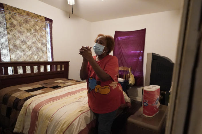 Marie Johnson talks about losing power and running water during a recent winter storm, Thursday, Feb. 25, 2021, inside her home in Houston. Local officials, including Houston Mayor Sylvester Turner, say they have focused their efforts during the different disasters on helping the underserved and under-resourced but that their work is far from complete. (AP Photo/David J. Phillip)