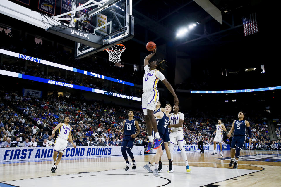 <p>LSU Tigers forward Naz Reid (0) dunks the ball against the Yale Bulldogs in the first round of the 2019 NCAA Men's Basketball Tournament held at VyStar Veterans Memorial Arena on March 21, 2019 in Jacksonville, Florida. (Photo by Matt Marriott/NCAA Photos via Getty Images) </p>