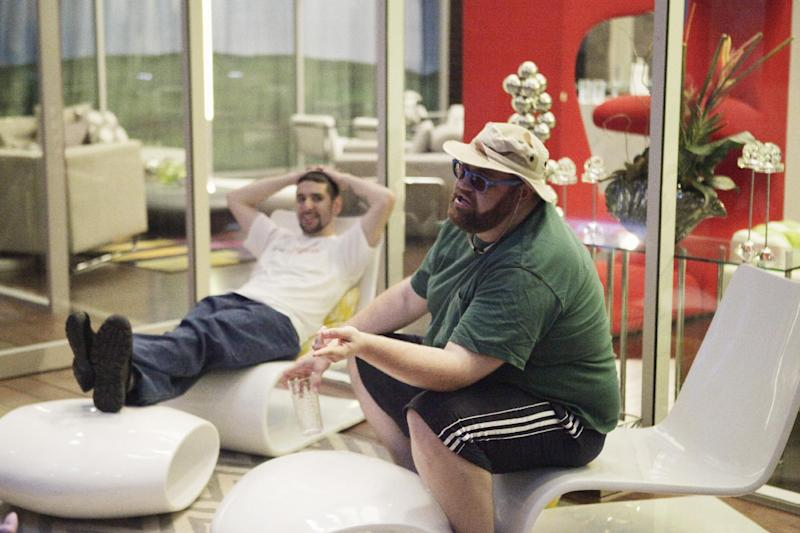 "This June 18, 2012 photo released by ABC shows contestants Apollo, left, and Jeffrey are shown during the premiere episode of ""The Glass House."" After failing to stop the debut of ABC's ""The Glass House,"" CBS tried another tactic against its competitor: sarcasm. CBS had argued in court that the ABC show is a copy of CBS' ""Big Brother."" On Wednesday, CBS issued a tongue-in-cheek release claiming it was developing a reality series called ""Dancing on the Stars"" _ a jab at ABC's ""Dancing With the Stars."" The mock series will air from the Hollywood Forever Cemetery in Los Angeles and feature what CBS called ""moderately famous and sort of well-known people"" who will compete by dancing on stars' graves, the network said. (AP Photo/ABC, Nicole Wilder)"