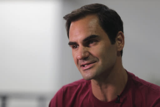 FILE - In this Sunday, Dec. 15, 2019, file photo, Roger Federer talks to an Associated Press reporter in Dubai, United Arab Emirates. Federer figures Rafael Nadal and Novak Djokovic both will surpass his men's record for Grand Slam titles. Federer also says he's OK with that because he had his moment on top. (AP Photo/Kamran Jebreili, File)