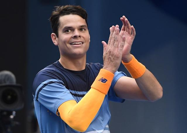 Canada's Milos Raonic celebrates after victory in his Australian Open men's singles fourth round match against Switzerland's Stanislas Wawrinka, in Melbourne, on January 25, 2016 (AFP Photo/William West)