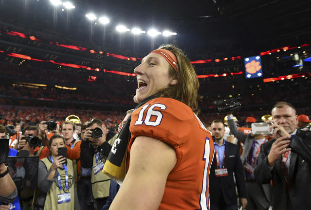 Clemson quarterback Trevor Lawrence (16) celebrates after their 30-3 win against Notre Dame in the NCAA Cotton Bowl semi-final playoff football game, Saturday, Dec. 29, 2018, in Arlington, Texas. (AP Photo/Jeffrey McWhorter)