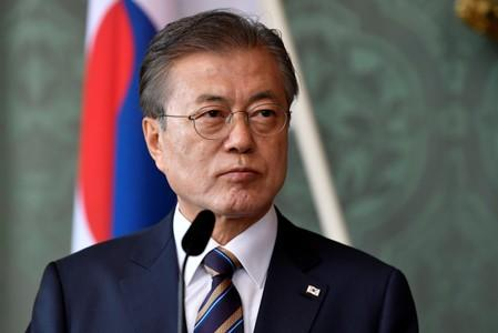 Japan curbs could drag on, hurt global economy - Moon