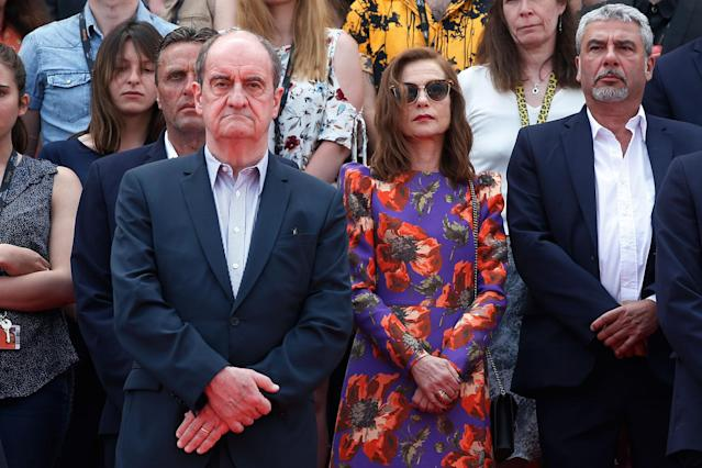 <p>Pierre Lescure, Cannes Film Festival president, centre left, and actress Isabelle Huppert, centre right, join staff to hold a moment of silence on the steps of the Palais du Festival, Tuesday, May 23, 2017 for the victims of the Manchester bomb blast. An apparent suicide bomber attacked an Ariana Grande concert as it ended Monday night, killing over a dozen people among a panicked crowd of young concertgoers, in Manchester, England. (AP Photo/Thibault Camus) </p>