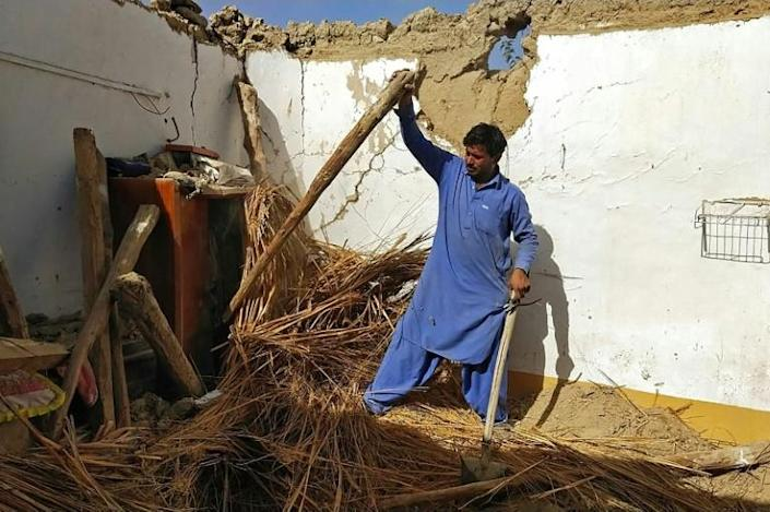 Many of the victims died when the roofs and walls of their mud houses collapsed after the 5.7 magnitude quake struck in darkness (AFP/Banaras KHAN)