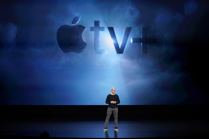 FILE - In this Monday, March 25, 2019, file photo, Apple CEO Tim Cook speaks at the Steve Jobs Theater during an event to announce new products, including Apple's steaming TV, in Cupertino, Calif. Streaming services ranging from Netflix to Amazon to Disney+ and others want us to stop sharing passwords. That's the new edict from the giants of streaming media, who are looking to discourage the common practice of sharing account passwords without alienating subscribers who've grown accustomed to the hack. (AP Photo/Tony Avelar, File)