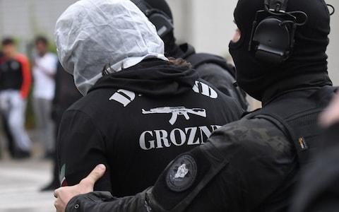 Heavily armed police on Sunday arrested and searched the home 20-year-old man in Strasbourg - Credit: PATRICK HERTZOG/ AFP
