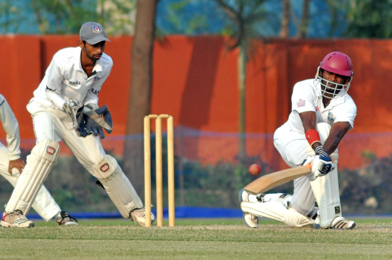 West Indies player N Deonarine in action during Day one of practice match between West Indies and Uttar Pradesh Cricket Association XI at the Jadavpur University Ground in Kolkata on Oct 31, 2013. (Photo: IANS)