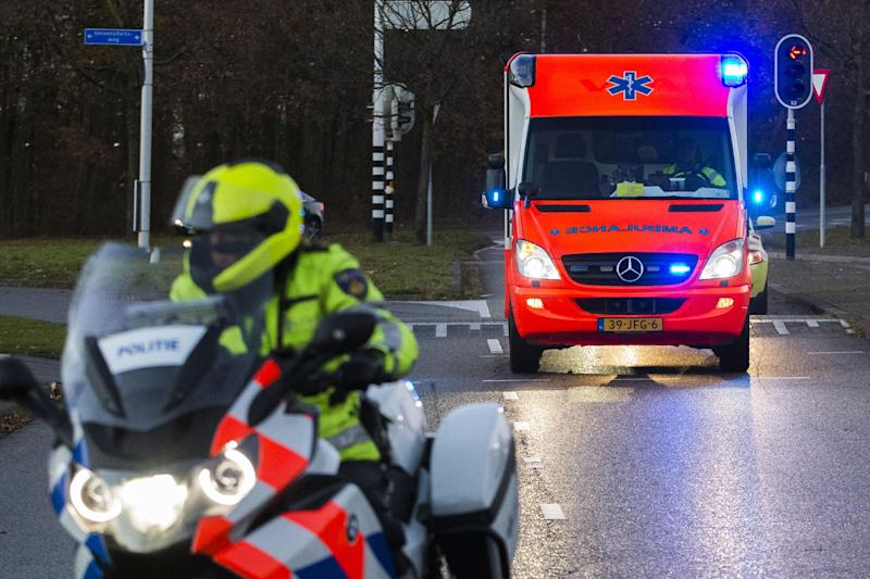 An ambulance carrying a Nigerian worker suspected of having Ebola arrives at the Emergency Hospital of the University Medical Center Utrecht in Utrecht, on December 6, 2014